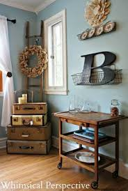 New Additions To The Dining Room Vintage Suitcases And An Antique Tea Cart