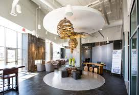 The Coil Apartments Leasing Office And Intimate El Inspired Lobby With Wi Fi