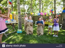 Kids Enjoying Sack Race At Backyard Birthday Party Stock Photo ... Backyard Birthday Party Ideas For Kids Exciting Backyard Ideas Domestic Fashionista Summer Birthday Party Best 25 Parties On Pinterest Girl 1 Year Backyards Mesmerizing Decorations Photo Appealing Catholic All How We Throw A Movie Night Pear Tree Blog Elegant Games Adults Architecturenice Parties On Water