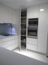 Blind Corner Kitchen Cabinet Ideas by Two Ovens In Vertical Alignment With Pantry Door Alongside To The
