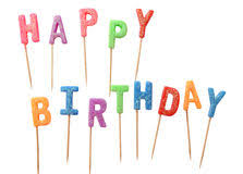 Colorful candles in letters saying Happy Birthday isolated on white background clipping path