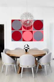 Melbourne Round Farmhouse Dining Room Contemporary With Hanging Artwork Gray Wall Mirrors Red Art