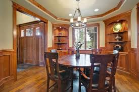Elegant Dining Room With Built In Shelves Round Table Leather Chairs