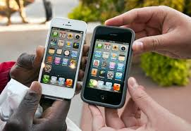 World makes merry as Apple iPhone 5 hits stores