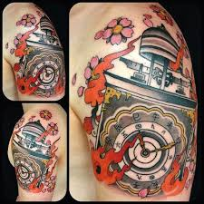 Grey And Red Ink Blossoms Clock Flame Tattoos On Shoulder