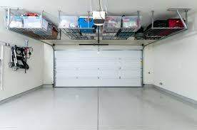 Traditional Garage with High ceiling & simple granite floors in