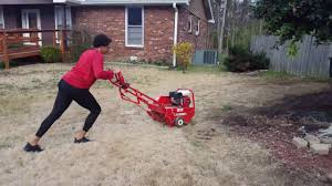 Aerating The Front Lawn With An Aerator From Home Depot - YouTube