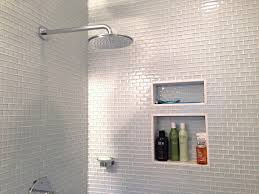 white bathroom designs with built in caddies and wall mount heads