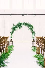 Elevate A Barn Setting With Rustic Chic Decor Like This Greenery Lined Aisle