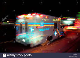 City night Ambulance responds racing to the scene with lights
