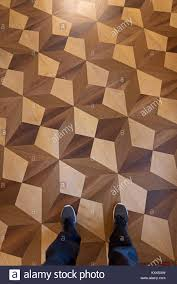 Person Standing With Sports Shoes On Elaborate Parquet Floor Top View