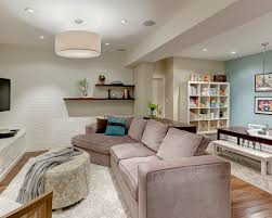 Example Of A Classic Underground Medium Tone Wood Floor Basement Design In Toronto With Blue Walls