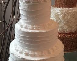 Fake 3 Tier Rustic Cake In White With Traditional Shell Piping