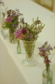 Scattered Glass Vases Autumn Style Wedding Flowers Jam Jars And Vintage Roses Rustic Tea Stained