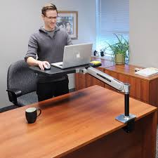 Ergotron Sit Stand Desk laptop users get on your feet thinking like harry