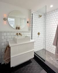 looking glossy white subway tile with wainscoting bathroom