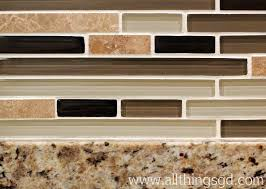 look how the glass tile backsplash contains all of the colors from