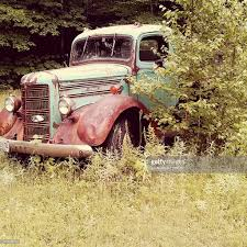 Abandoned Rusty Pickup Truck By Plant On Grass Stock Photo | Getty ... Old Abandoned Rusty Truck Editorial Stock Photo Image Of Vehicle Stock Photo Underworld1 134828550 Abandoned Rusty Frame A Truck In Forest Next To Road Head Axel Fender 48921598 And Pickup Retro Style Blood Brothers With Kendra Rae Hite Youtube Free Images Farm Wheel Old Transportation Transport In The Winter Picture And At Field Zambians Countryside Wallpaper Rust Canada Nikon Alberta Vintage Serbian Mountain Village Editorial