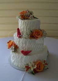 Rustic Wedding Cake With Non Smooth Icing And Fresh Flowers