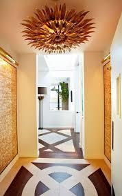 copper sharp starburst flush mount lighting in the hallway ceiling