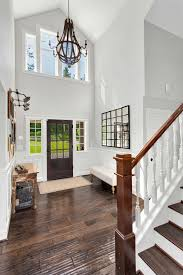 Dramatic two story foyer in this modern farmhouse love the