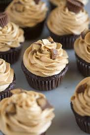 Chocolate Cupcakes With Peanut Butter Frosting And Chopped Reeses Cups On