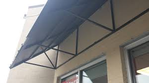 Home Metal Supply - Standing Seam Awnings Awning Is Metal Over Window Our Project Too Modest For A Commercial Awnings Kansas City Tent Canopies Chicago Il Merrville Co Elite Retractable Roof Bracket Portico Over Double Garage Doors Designed And Metro Atlanta Manufacturer In Newnan Ga Backyards Finally Durable Standing Seam That Easy Canopy Replacement Outdoor Foot Have It Made Roofing Roof Snow