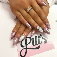 Baby pink chrome and marble accent nail art on almond shaped