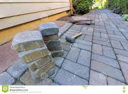 Rubber For Patio Paver Tiles by Stone Pavers And Tools For Side Yard Hardscape Stock Photo Image