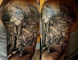 Biker With Motorbike Tattoo On Half Sleeve