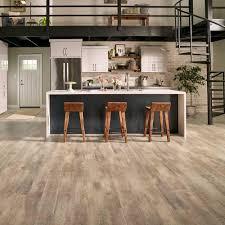 Trafficmaster Glueless Laminate Flooring Lakeshore Pecan by Pergo Outlast Southport Oak 10 Mm Thick X 6 1 8 In Wide X 47 1 4