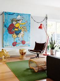 Unique Artwork And Bright Accessories Give This Earthy Kids Room A Fun Vibe
