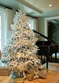 A Flocked Christmas Tree Makes For Very White