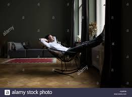 Man Relaxing On Rocking Chair In His Living Room Stock Photo ... Mid Century Rocking Chair Retro Modern Fabric Upholstered Wooden Chairs Style Armchair Relax Sleep Vner Panton Licensed Reproduction Relax Lounge Rocking Chair For Matzform Hot Item Cy2273 Top Quality Antique Relaxing Seller View Bodian Product Details From Bazhou City Bodian Fniture Co Ltd On Alibacom Sobuy With Adjustable Footrest Side Bag Fst18dg Baby Babies Kids Cots Amazoncom Lixiong Outdoor Garden Eclecticosineu Caline Parc Homhum Grey Padded Seat Rocker Nursery Comfortable Glider