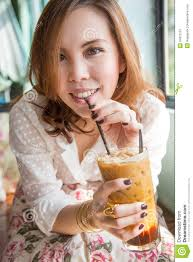 Woman Drinking Iced Coffee Stock Image