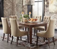 Modern Rustic Dining Room Two Toned Mahogany Wood Chairs Brown Varnishes Wooden Table Shiny Glass