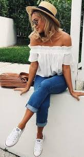 Blue Cuffed Jeans An Off The Shoulder White Top And Converse