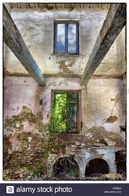 Interior Of Abandoned Farmhouse In Italy Exposed Beams Rubble Doorways Plastered Walls Crumbling Nature Regaining A Foothold