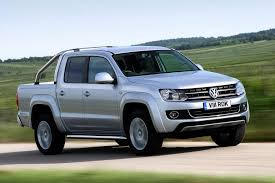 VW Prices Amarok Pickup Truck From £16,995 In The UK | Carscoops Vw Amarok Gets New 201 Hp V6 Diesel Canyon Special Edition Is The Volkswagen Set To Come Us Carbuzz Tdi Review The Truck That Ate A Golf Youtube 2015 First Drive Review Digital Trends Editorial Photo Image Of Quad Large 66765786 Might Unveil Pickup Concept In York Roadshow Knocking Socks Off Competion Since Pick Up Cover For Truck Used 2014 Dc Trendline 4motion For Sale 2017 Hunter Motor Group Prices Pickup From 16995 Uk Carscoops Five Top Toughasnails Trucks Sted