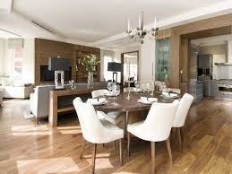 Another Example Of A Living Room With Rug And An Adjacent Dining Area Without One