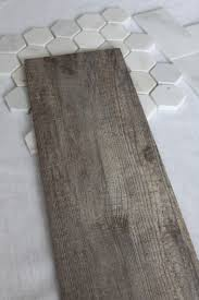the bathroom floor will wear this tile it looks like a weathered