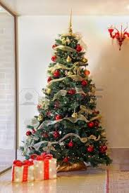 Tall Christmas Tree With Colorful Ornaments Inside Home Interior