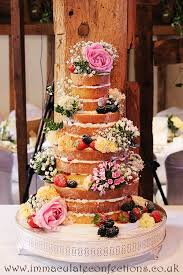 Pictured Here Adorned With Plenty Of Fresh Fruit And Wild Looking Flowers Naked Cakes Are A Great Choice For Rustic Or Barn Weddings