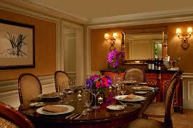 Opulent Dining Room With A Rich Wood Table Seating For Six And Centerpiece Of