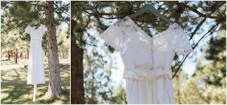 Vintage Lace Wedding Gown Hangs From A Pine Tree In The Woods At This Backyard