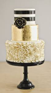Black White And Gold Wedding Cake With Ruffles