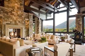 Rustic Modern Living Room House Design With Stone Wall White Sofa And Chairs Plus Fireplace Glass Window Ideas Elegant Colorado Home