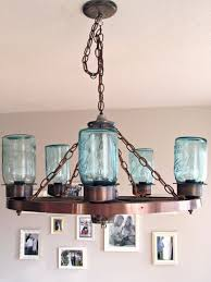 wagon wheel light fixture with blue jars craft ideas for