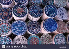 detail of stacks of circular ceramic tiles for sale at souvenir