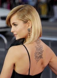 Word Sound Power Lettering Tattoo On Celebrity Mena Suvari Upper Back